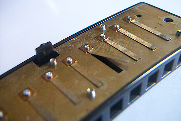 repair a broken harmonica reed